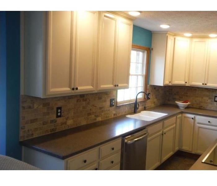 Cabinets and walls replaced.  Customer chose to upgrade the kitchen cabinets and backsplash.