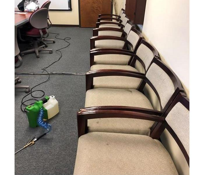 Row of office chairs that are stained and soiled