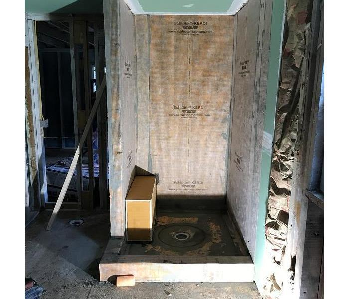 Progression photo of the new bathroom being put in by our reconstruction team.