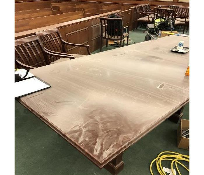 Table covered in dust after reconstruction