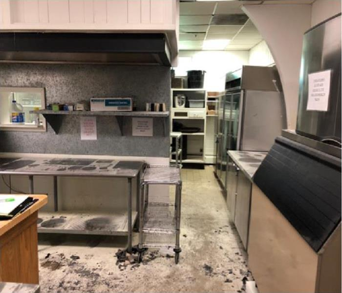 Smoke, soot and fire extenguisher residue cover this local commercial kitchen after a small fire