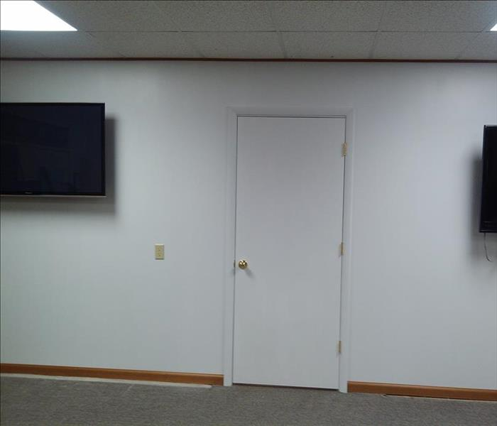 Completed reconstruction of complete wall with door.  The crews even hung the new T.V.'s.