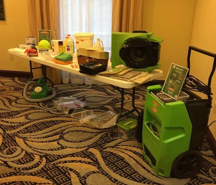SERVPRO products and equipment on display at a Continuing Education Class.