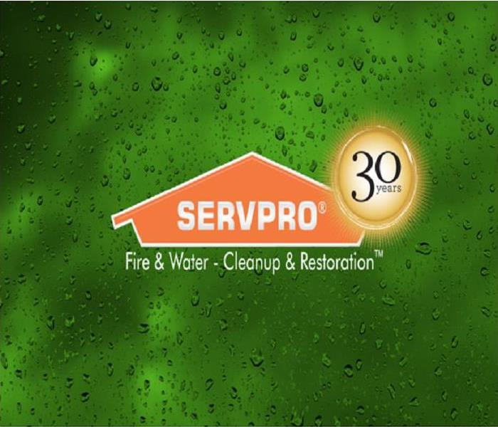 green water background with Servpro logo and 30 years logo