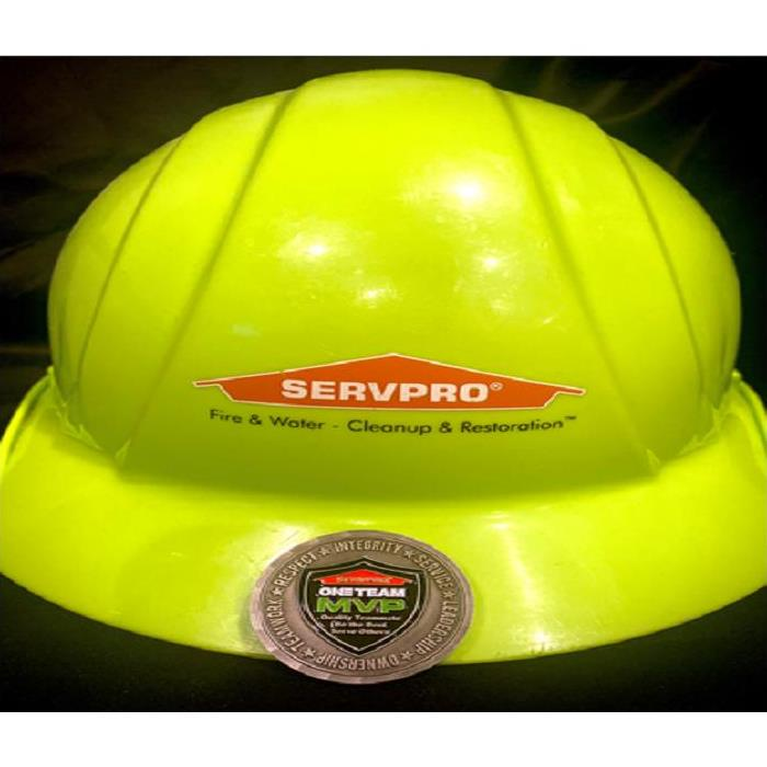 SERVPRO hard hat with our company challenge coin.