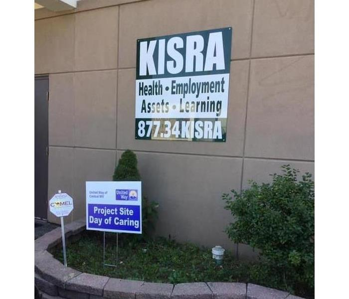 Front of KISRA Building with building sign and United Way sign Day of Caring
